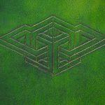 Custom geometrical design cut into green leather