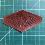 Custom geometrical design sits atop a cutting board surface