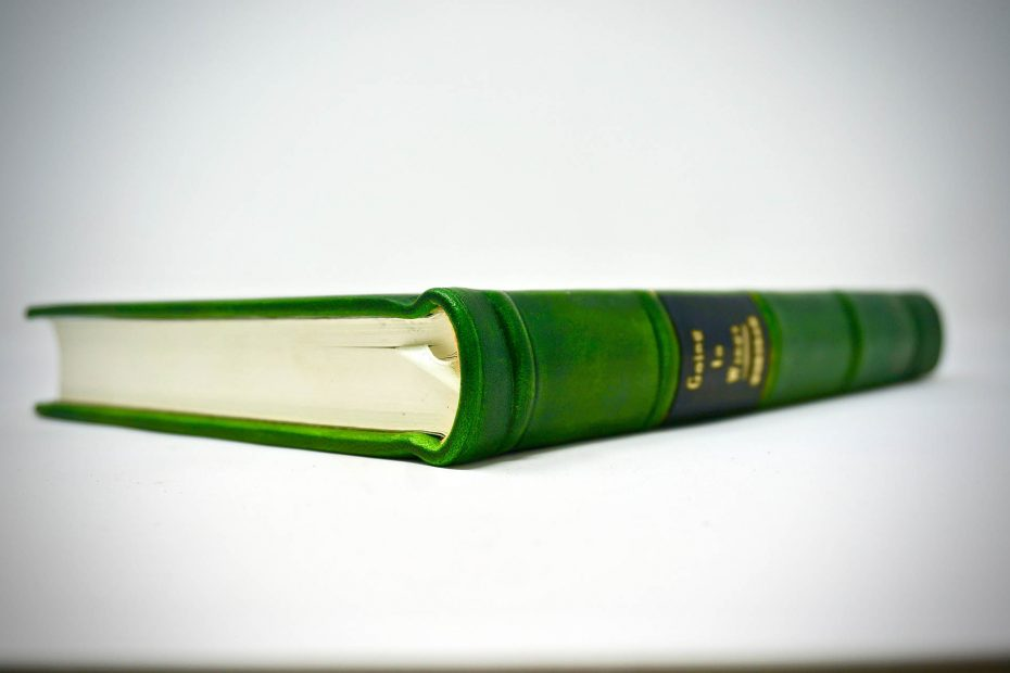 Green leather book with silk ribbon, custom made by Boston Harbor Bookbindery