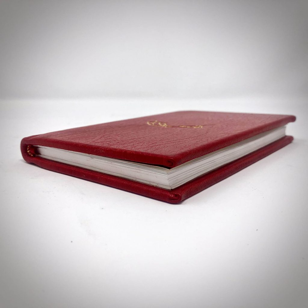 Boston Harbor Bookbindery www.bostonharborbooks.com  How to Relax; Custom red leather book, designed and executed for the client's personal library as one fo their all-time favorite books.