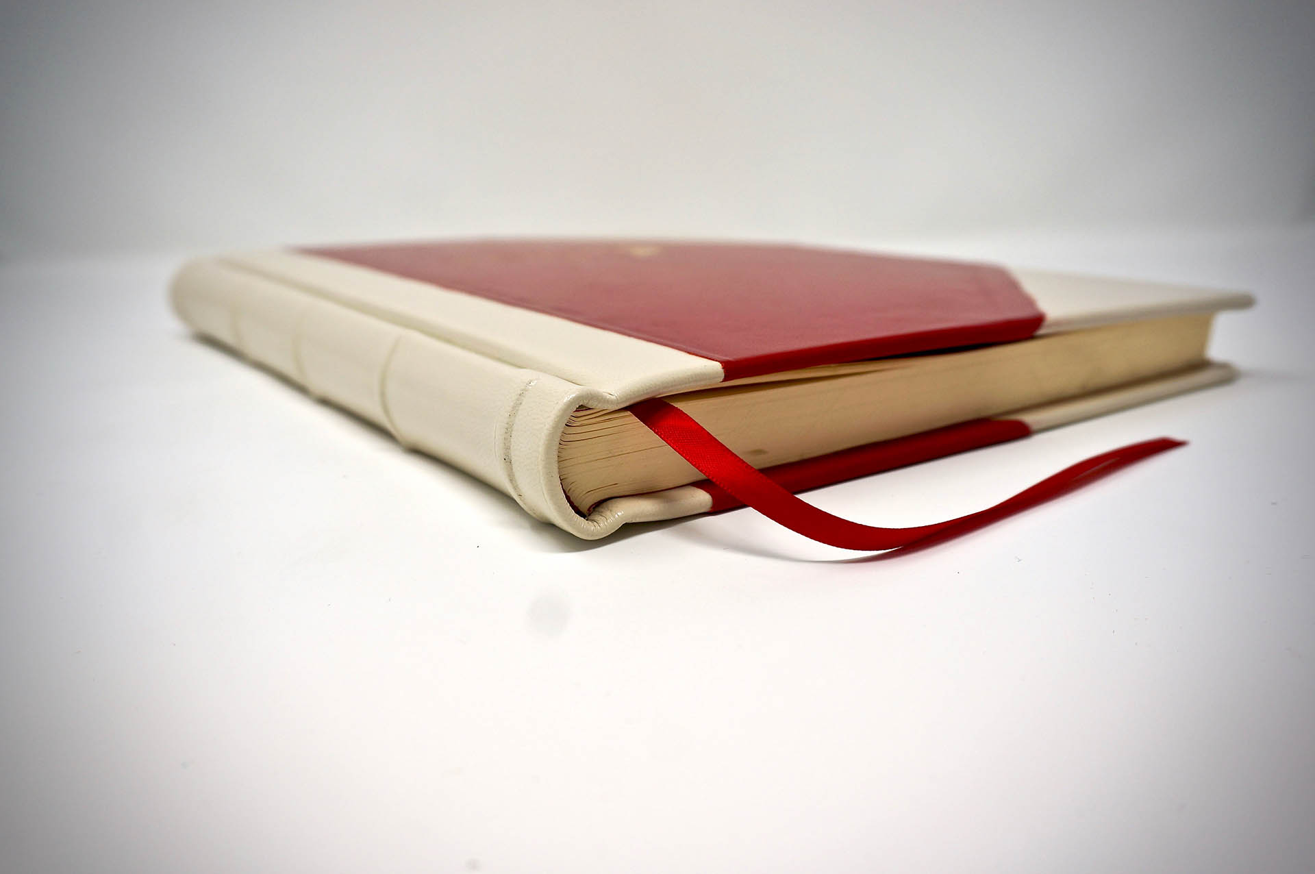 Boston Harbor Bookbindery www.bostonharborbooks.com  Monaco Sailing Journal; Custom red/white leather book, designed and executed for the client's yacht adventures.